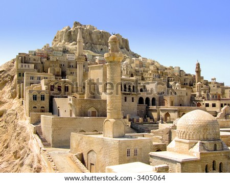 Old medieval Middle East city on the hill - stock photo