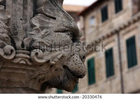 old medieval street statue gargoyle in croatian town Dubrovnik - stock photo