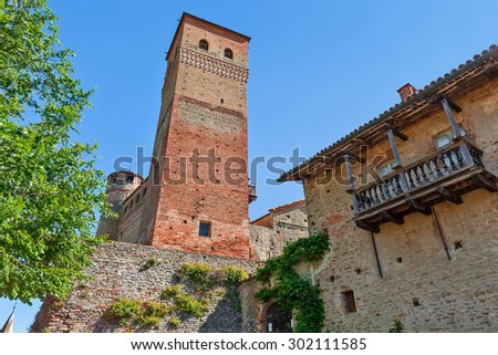 Old medieval tower under blue sky in Serralunga d'Alba in Piedmont, Northern Italy. - stock photo