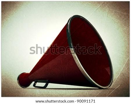 old megaphone in grunge photo - stock photo