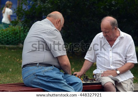Old men are playing chess in a park, on July 6, 2016 in Kiev, Ukraine - stock photo