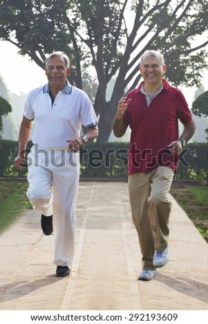Old men jogging in a park - stock photo