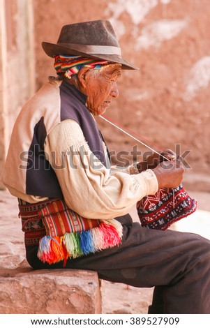 Old men knitting at taquile island in puno peru. - stock photo