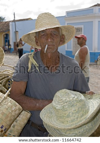 old men selling traditional hats on the street -trinidad - stock photo