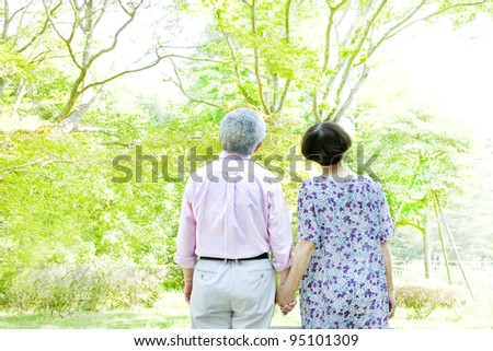 Old men tying a hand - stock photo