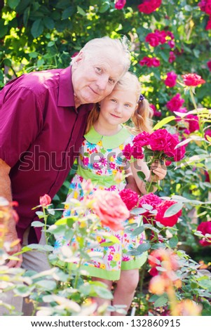 old men with happy girl outdoor - stock photo