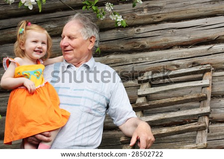old men with little girl outdoor - stock photo