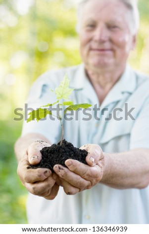 old men with plant outdoor - stock photo