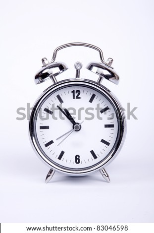 Old metal alarm clock. - stock photo