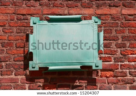old metal and vintage shields l (tablet) on wall