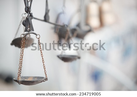 Old metal balance at antique store - stock photo