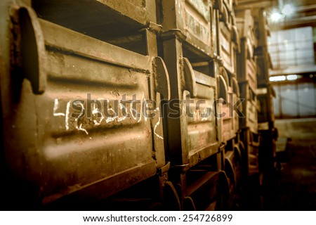 Old metal boxes stacked in storehouse of factory