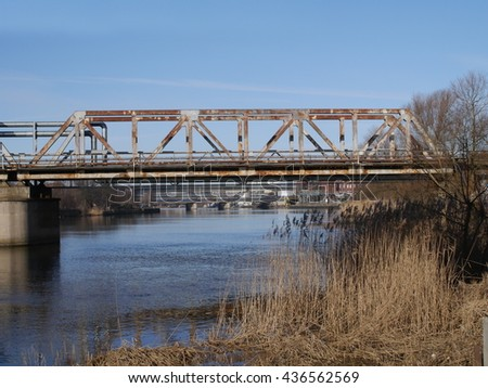 old metal brigge over river - stock photo