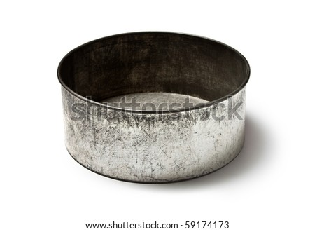 Old metal cake baking pan - stock photo