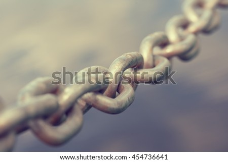Old metal chain on a blurred background - stock photo
