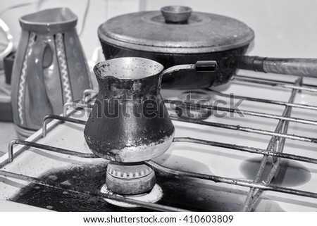 old metal coffee maker, making coffee on gas                                - stock photo