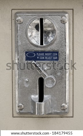 Old metal coin slot panel from a coin operated machine - stock photo