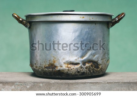 Old metal dirty aged saucepan - stock photo