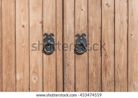 old metal door handle knocker - stock photo