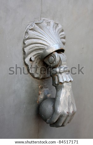 old metal door handle knocker - stock photo