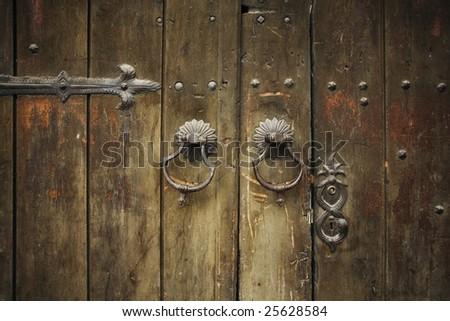 old metal door handle knockers - stock photo