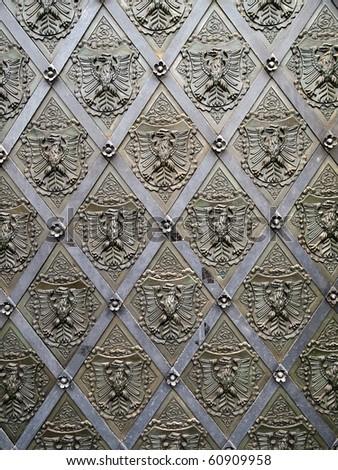 old metal door with heraldry - stock photo