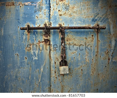old metal door with lock - stock photo
