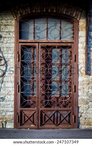 Old metal door with rust - stock photo