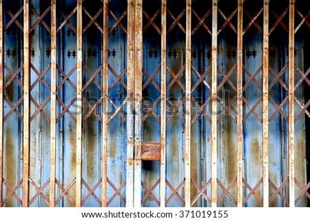 old metal fence door - stock photo