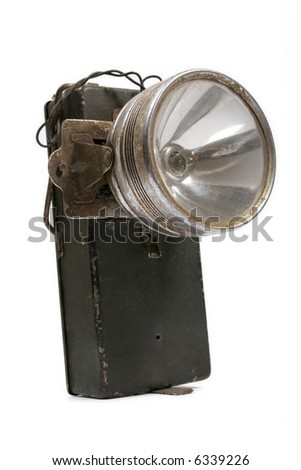 Old metal flashlight of batteries