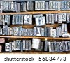 old metal fonts in wooden case, many letters - stock photo