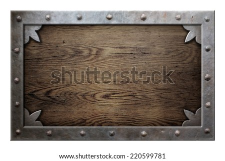 old metal frame over wooden background isolated - stock photo