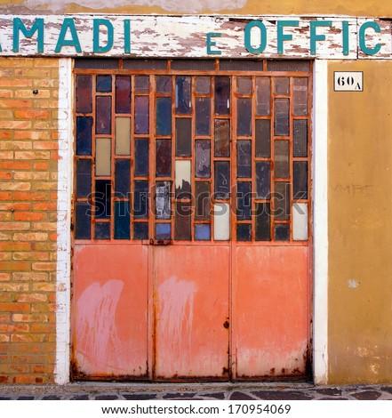 old metal garage door with glass windows  - stock photo