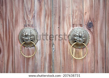 old metal handle Chinese style on wooden door background - stock photo