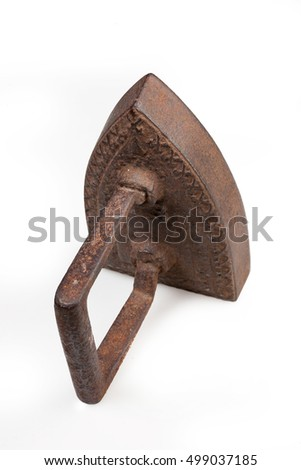 Old metal iron on isolated studio white background