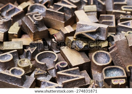 Old metal letterpress printing blocks - stock photo
