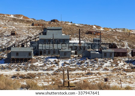 Old metal mine buildings in Bodie, California, USA. - stock photo