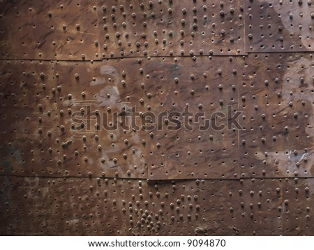 Old metal plate door - stock photo