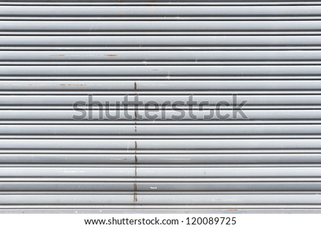old metal roller shutter door - stock photo
