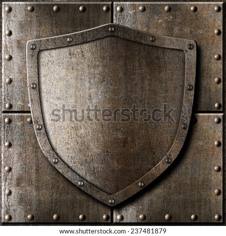 old metal shield over armor background - stock photo