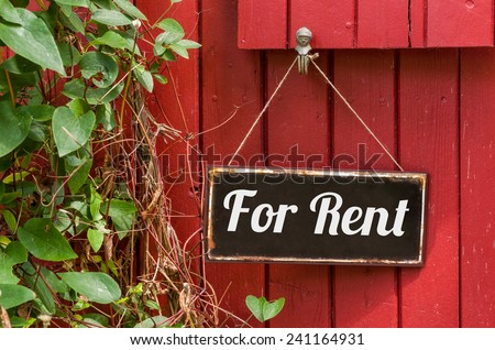 Old metal sign with the inscription For Rent - stock photo