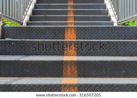 Old metal stairs of the overpass - stock photo
