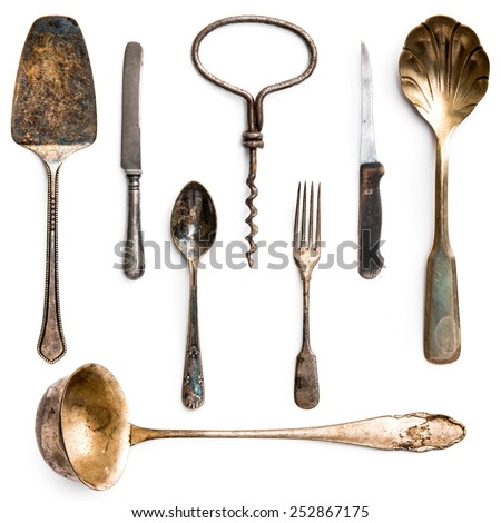 old metal utensils on a white background - stock photo