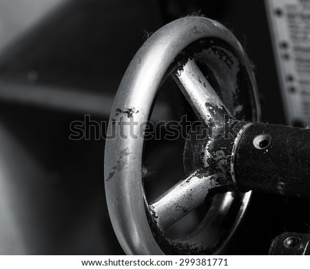 Old metal valve handle background - stock photo