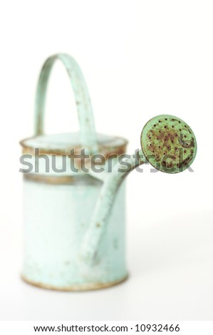 old metal watering can, selective focus - stock photo