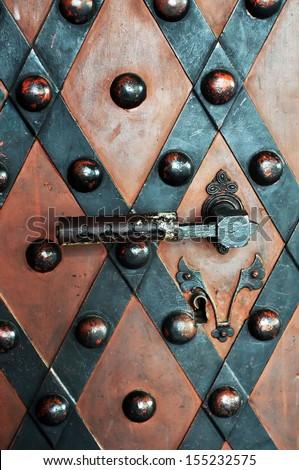 Old metallic door ,detail. - stock photo