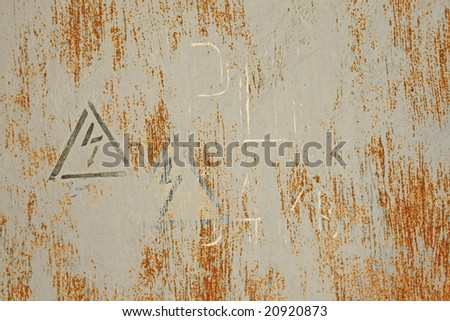 Old metallic wall with warnings signs - stock photo