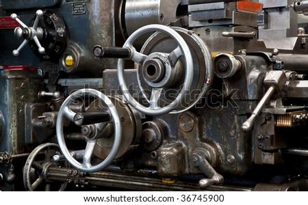 Old metalwork lathe - stock photo