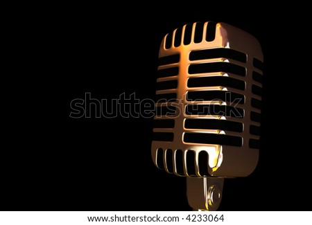 Old microphone on the black background - stock photo