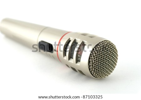 Old microphone over white. Shallow DOF. - stock photo